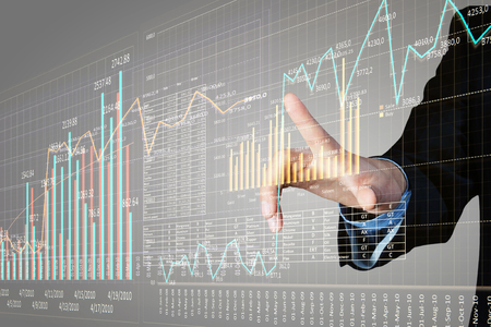 financial concept: Close view of businessman touching with finger on screen market infographs