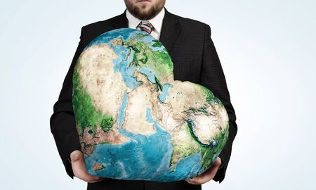 businessman carrying a globe: Businessman holding world in his hands. Elements of this image are furnished by NASA Stock Photo