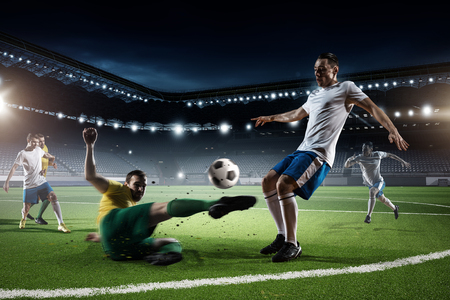 challenger: Players fight over control of ball during football game Stock Photo