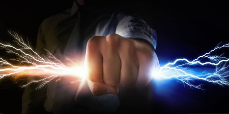 clench: Close up of businessman grasping light in fist