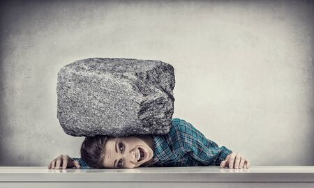 suppressed: Women crushed by the weight of stone o table