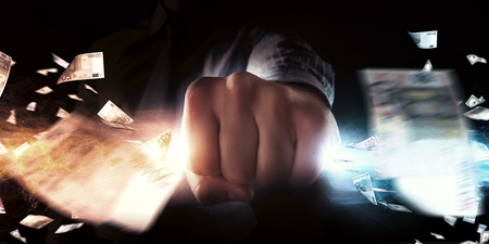 grasping: Close up of businessman grasping light in fist