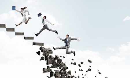 collapsing: Young people running up collapsing staircase representing success concept