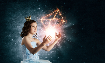 queen of angels: Little girl princess in blue dress with diadem on head Stock Photo