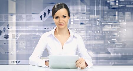 high tech: Businesswoman with tablet pc against high tech blue background Stock Photo
