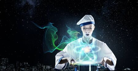 Pretty woman cook in hat and apron with pot in hands. Elements of this image are furnished by NASA