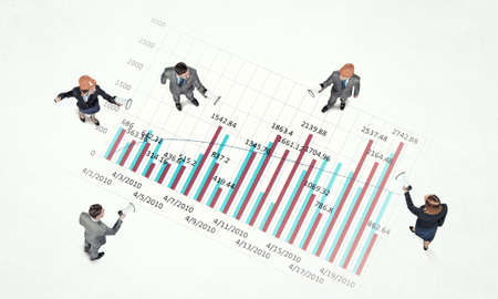 rise to the top: Top view of business people and graphs and diagrams on floor