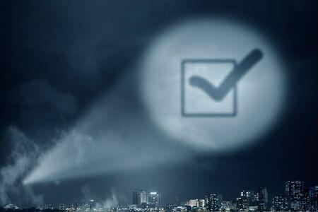 tick box: Conceptual image with tick box in spotlight Stock Photo