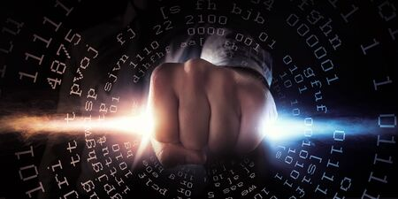 close fist: Close up of businessman grasping light in fist