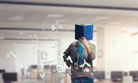 higher intelligence: Young hipster girl with opened book in hands