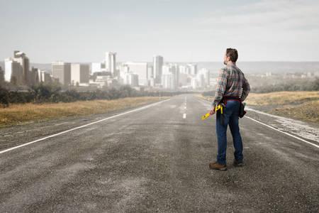 journeyman: Builder man in checked shirt with tool belt on waist