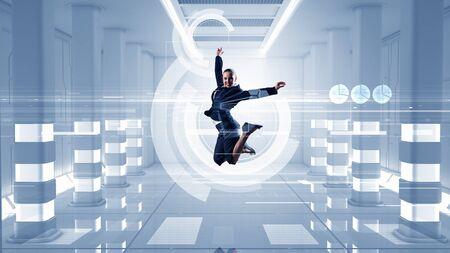 futuristic interior: Young dancing businesswoman in suit in futuristic interior