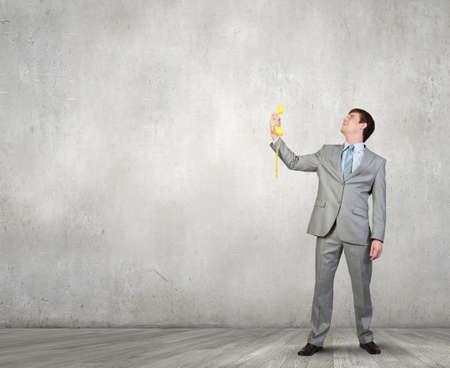 phone handset: Handsome businessman talking on yellow phone handset