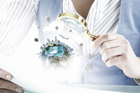 optical people person planet: Close view of businesswoman examining Earth planet with magnifying glass. Elements of this image are furnished by NASA