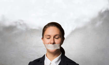 hearsay: Young businesswoman with tape on mouth and tired hands