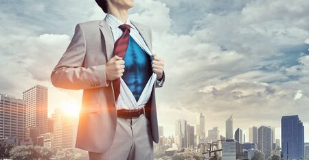 proffesional occupation: Office worker opening his shirt on chest like superhero