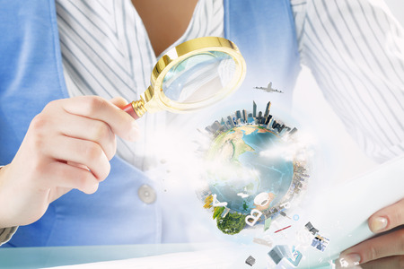 optical people person planet: Close view of businesswoman examining Earth planet with magnifying glass. Stock Photo