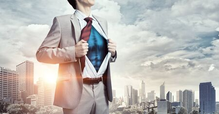 undress: Office worker opening his shirt on chest like superhero
