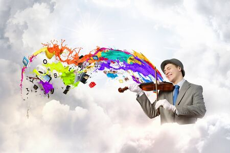 fiddles: Funny man in hat playing violin presenting celebration concept