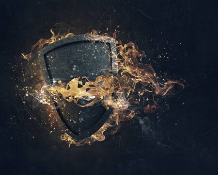 joust: Stone broken shield in fire flames on dark background Stock Photo