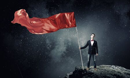 Young student guy with color blank waving flag Stock Photo