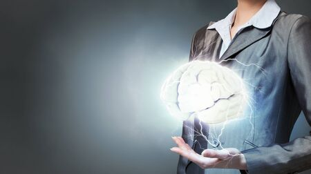 holding close: Close view of businesswoman holding in hands human mind concept