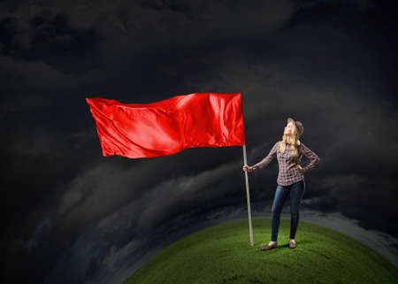 Young girl in casual with blank waving flag in hand Stock Photo