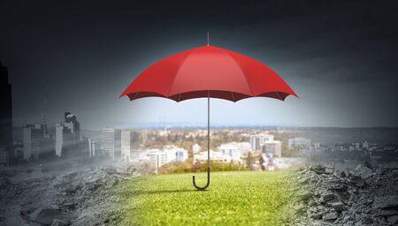 sotto la pioggia: Conceptual image with color umbrella in sky under rain
