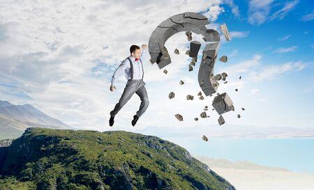 unknown men: Emotional businessman destroying with arm stone question mark