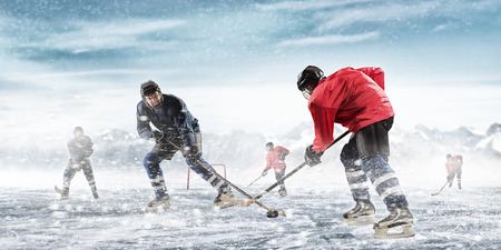 frozen winter: Ice hockey players on the ice outdoors