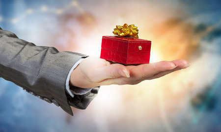 lady in red: Close view of businesswoman hand holding gift box