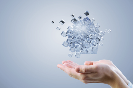 Conceptual image with 3D rendering cube figure in male palms