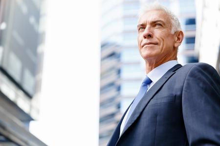 trachea: Portrait of confident businessman in suit outdoors