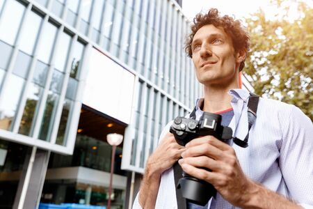 teabag: Happy male tourist walking in city with camera