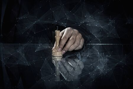 chess move: Close up of man hand making chess move on dark background