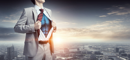 Office worker opening his shirt on chest like superhero