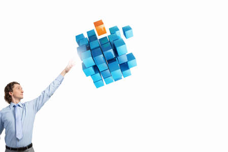 hand touch: Businessman reaching hand to touch 3D rendering cube figure