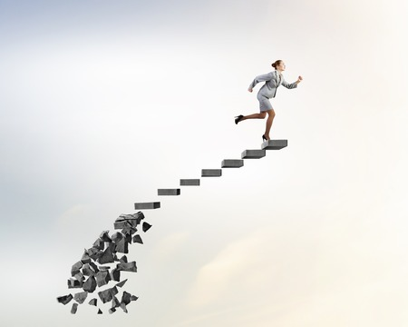 collapsing: Businesswoman climbs steps of collapsing finance ladder Stock Photo