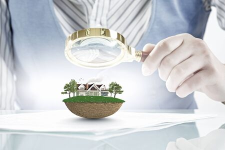 botanist: Woman botanist checking green ecology concept with magnifying glass