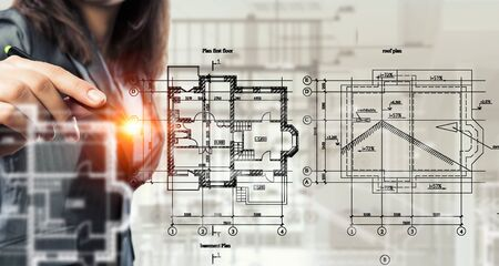 female architect: Female architect working with virtual construction plan