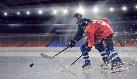 Hockey players shoot the puck and attacks