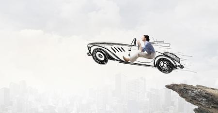 funny car: Young humorous woman driving drawn funny car