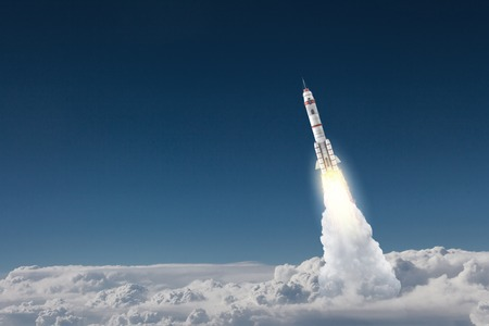Military missile flying high in blue sky