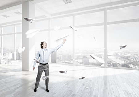 careless: Careless businessman with paper plane in office interior