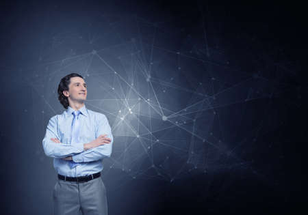 Young confident businessman with arms crossed on chest against connection concept background