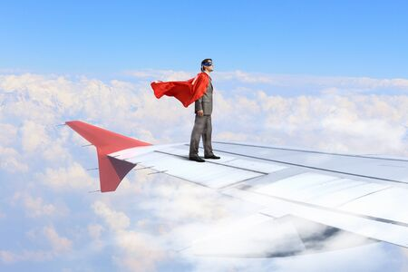 super man: Super man standing on edge of airplane wing