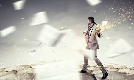 Aggressive businessman in suit throwing burning molotov cocktail