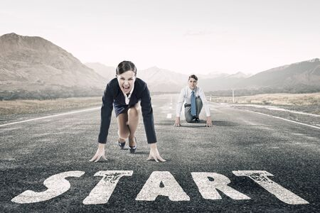 compete: Young determined businesspeople standing in start position ready to compete