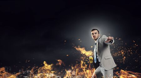 molotov: Aggressive businessman in suit throwing burning molotov cocktail