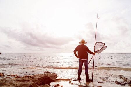wade: Picture of fisherman fishing with rods